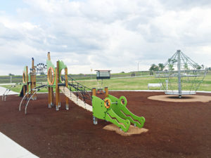 the Sanctuary playground in Fletcher contains Proludic's J2711 Croco (left foreground), and  DX-2300F Spinning net (right background)